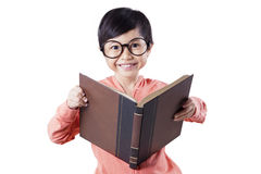 Cute child reading book in studio Stock Photography