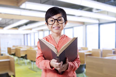 Cute child reading literature in the classroom Royalty Free Stock Photos