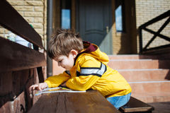 Cute child reading magazine outdoor Royalty Free Stock Photography