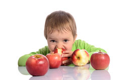 Cute child with red apples Stock Photography