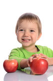 Cute child with red apples Royalty Free Stock Image