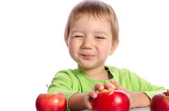 Cute child with red apples stock photo