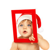 Cute child with red Christmas frame Royalty Free Stock Image