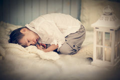 Cute child relaxed on warm woolen plaid at home Royalty Free Stock Photos