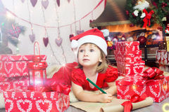 Cute child in santa hat Royalty Free Stock Photos