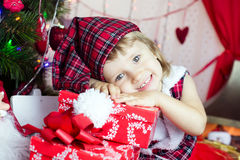Cute child in santa hat Stock Photos