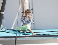 Cute child on sea catamaran / yacht Royalty Free Stock Photo