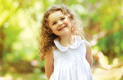 Cute child shone with happiness. Curly hair, charming smile stock image