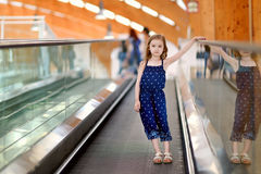 Cute child in shopping center on moving staircase Royalty Free Stock Image