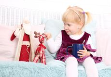 Cute child sit in chair with christmas toys royalty free stock images