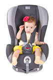 Cute child sitting in a car seat Stock Photo