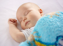 Cute child is sleeping in bed Royalty Free Stock Photo