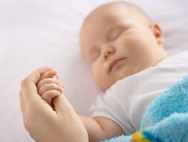 Cute child is sleeping in bed Stock Image