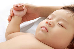Cute child is sleeping in bed Royalty Free Stock Images