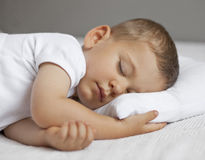 Cute child. Is sleeping in bed stock images
