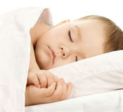 Cute child is sleeping in bed stock photography