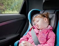 Cute child sleeping in a car Royalty Free Stock Photography