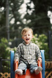 Cute child on slide Royalty Free Stock Images