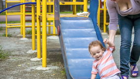 Cute Child On a Slide In Playground Royalty Free Stock Images