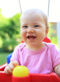 Cute child smiling in swing. Young cute child smiling in swing royalty free stock photos