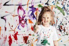 Cute child with smuges of colorful paint Stock Images