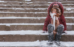 Cute child on the snow Royalty Free Stock Photos