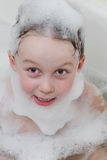 Cute child in soap foam Royalty Free Stock Image