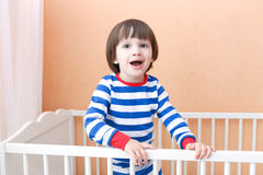 Cute child standing in bed Stock Photography