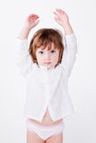 cute child standing with hands  up Royalty Free Stock Photography