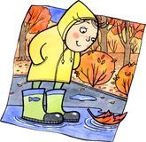 Cute child standing in a puddle Stock Photography