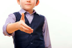 Cute child in suit stretching out hand Royalty Free Stock Photo