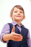 Cute child in suit stretching out hand Stock Photography