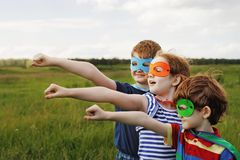 Cute child in Super hero costume. Superhero strong people concept stock image