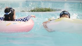 Asian happy brother and sister playing in pool with smile face. stock video