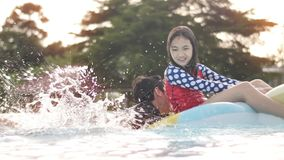 Asian happy brother and sister playing in pool with smile face. stock video footage