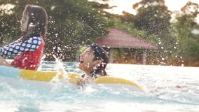 Asian happy brother and sister playing in pool with smile face. stock footage