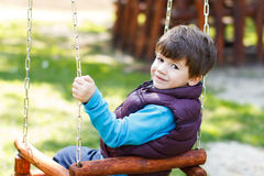 Cute child swing at outdoor Royalty Free Stock Image