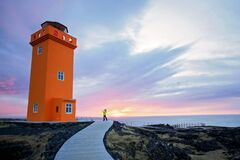 Free Cute Child Taking Picture Of Lighthouse In Lava Field In Beautiful Nature In Snaefellsjokull National Park In Iceland, Autumntime Stock Image - 186421071