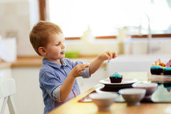 Cute child tasting cookies Stock Photography