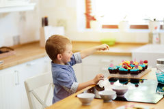 Cute child tasting cookies Stock Photo