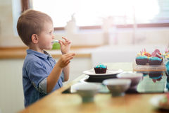 Cute child tasting cookies Royalty Free Stock Photos