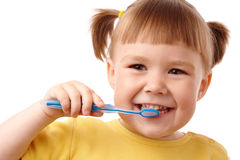 Cute child with toothbrush Stock Photos