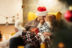 Cute child touching her father with nose while sitting on his kn Royalty Free Stock Images