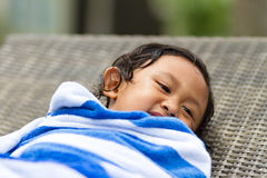 Cute child in towel after swimming Stock Photos