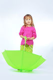 Cute child with umbrella Stock Photos