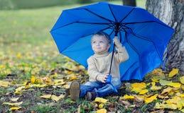 Cute child with umbrella autumn Stock Images