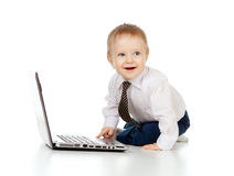 Cute child using laptop. Cute baby boy using laptop Stock Image