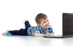 Cute child using a laptop Stock Images