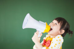 Cute child  using a megaphone Royalty Free Stock Photos