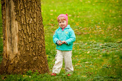 Cute child walking in autumn park Royalty Free Stock Photo